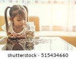 asian cute girl saving money... | Shutterstock . vector #515434660