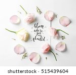Stock photo quote bloom where you are planted written on paper with petals and flowers top view 515439604