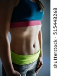 Small photo of Macro pose of a well built abdomen of a woman