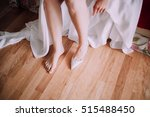 elegant bride wears shoes.... | Shutterstock . vector #515488450