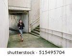 urban female runner training on ... | Shutterstock . vector #515495704