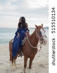woman on horse at the beach | Shutterstock . vector #515510134