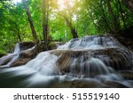 waterfall in natural deep forest | Shutterstock . vector #515519140