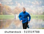 athlete at the lake running... | Shutterstock . vector #515519788