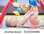 Sweet Baby Laying And Playing With Toys On Carpet - stock photo
