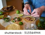 making tacos at home in kitchen | Shutterstock . vector #515564944
