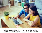 happy couple with laptop... | Shutterstock . vector #515615686