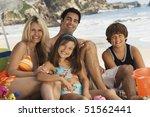 family in swimwear sitting on... | Shutterstock . vector #51562441