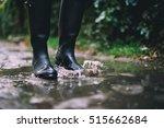 woman in black rubber boots... | Shutterstock . vector #515662684
