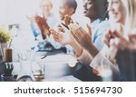 photo of partners clapping... | Shutterstock . vector #515694730