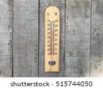 thermometer on wooden background | Shutterstock . vector #515744050