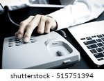 closeup of dialing a telephone... | Shutterstock . vector #515751394