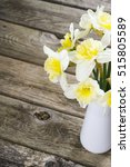 white daffodils at china vase... | Shutterstock . vector #515805589