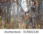 Small photo of man hunter outdoor in autumn forest hunting alone