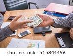 businessman paying dollars.... | Shutterstock . vector #515844496