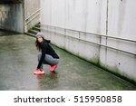 sporty woman lacing running... | Shutterstock . vector #515950858