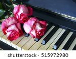 pink roses on vintage piano... | Shutterstock . vector #515972980