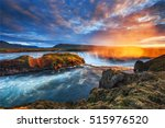 godafoss waterfall at sunset.... | Shutterstock . vector #515976520