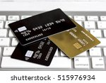 credit cards on the keyboard... | Shutterstock . vector #515976934