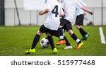 kids play soccer football game | Shutterstock . vector #515977468