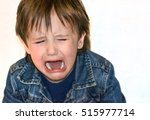 Small photo of Little boy is crying on a white background. Tantrum child