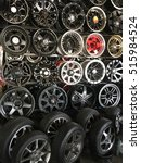 Small photo of PAHANG, MALAYSIA - NOV 15, 2016 : View of variety of brand new, colours, and designed alloy rims and wheels on display shelf for sale in a garage wheel shop in Kuantan Pahang, Malaysia.