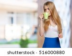 young woman on studio... | Shutterstock . vector #516000880