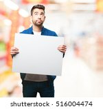 young man holding a banner | Shutterstock . vector #516004474