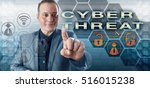 Small photo of Happy cyberspace security expert in gray suit is touching CYBER THREAT onscreen. Information technology metaphor and business concept for security risk to critical computing network infrastructure.