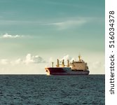red cargo ship  bulk carrier ... | Shutterstock . vector #516034378