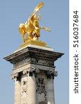 Small photo of PARIS, FRANCE - JUNE 05, 2008: Golden sculpture, in one of the columns of the bridge Alexander III