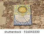 Ancient Sundial On A Wall