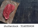a piece of raw beef steak on... | Shutterstock . vector #516050434