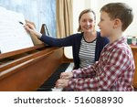 Boy With Music Teacher Having...
