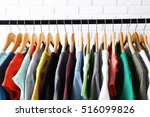 colorful t shirts on hangers...   Shutterstock . vector #516099826