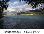 Small photo of Lake Serre Poncon with Alps in background, Hautes Alpes, Provence, France