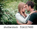 young couple embracing near... | Shutterstock . vector #516117400