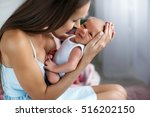 young mother holding her... | Shutterstock . vector #516202150