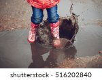 child wearing pink boots... | Shutterstock . vector #516202840