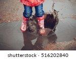 child wearing pink boots...   Shutterstock . vector #516202840