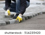 Paving Stone Worker Is Putting...