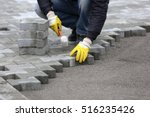 paving stone worker is putting... | Shutterstock . vector #516235426