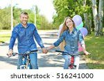 happy couple riding bicycles in ...   Shutterstock . vector #516241000