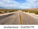 Two Lane Desert Highway Betwee...