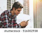 boy with the mobile phone on... | Shutterstock . vector #516302938