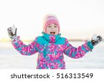 Happy Little Girl With Snowball ...
