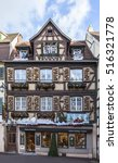 Small photo of COLMAR,FRANCE-DEC 6: Image of traditional Alsatian half-timbered houses decorated in winter holidays in Colmar,France on December 6,2013.