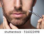 man during surgery filling...   Shutterstock . vector #516322498
