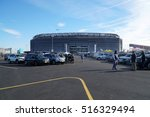 Small photo of New Jersey, USA - November 2016: Exterior Metlife Stadium before a New York Jets american football game. Fans tailgate in parking lot before enter arena to cheer on team.