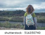 A Young Woman Is Standing By A...
